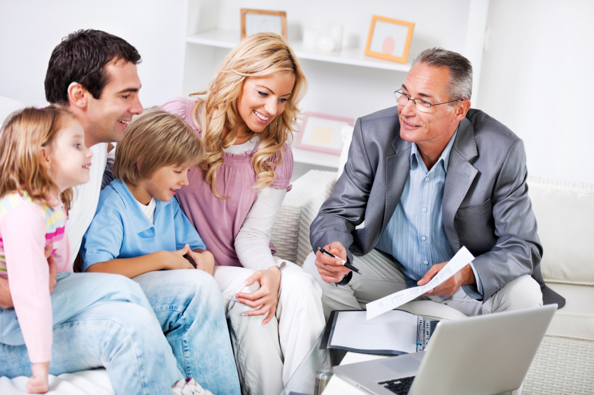Young couple with children meeting with  Insurance Agent.